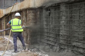 Spraying Gunite / Concrete
