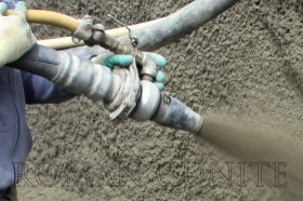 Close-up of nozzle Spraying Gunite / Concrete